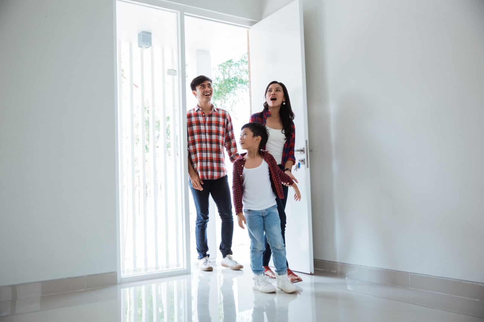 Buyers entering a home